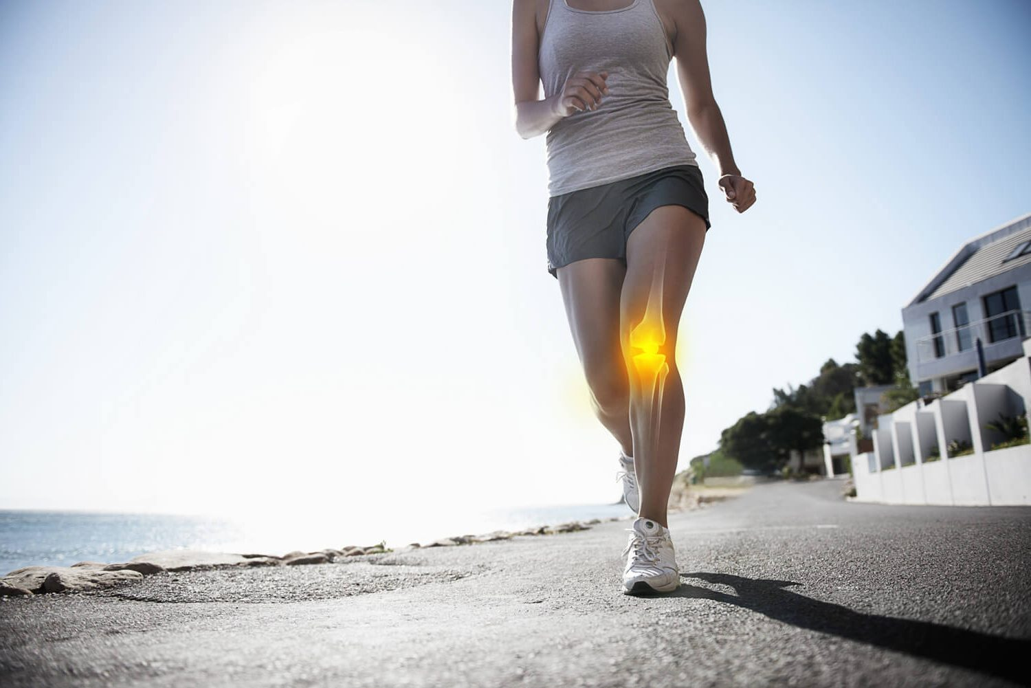 young woman runnning with knee problems